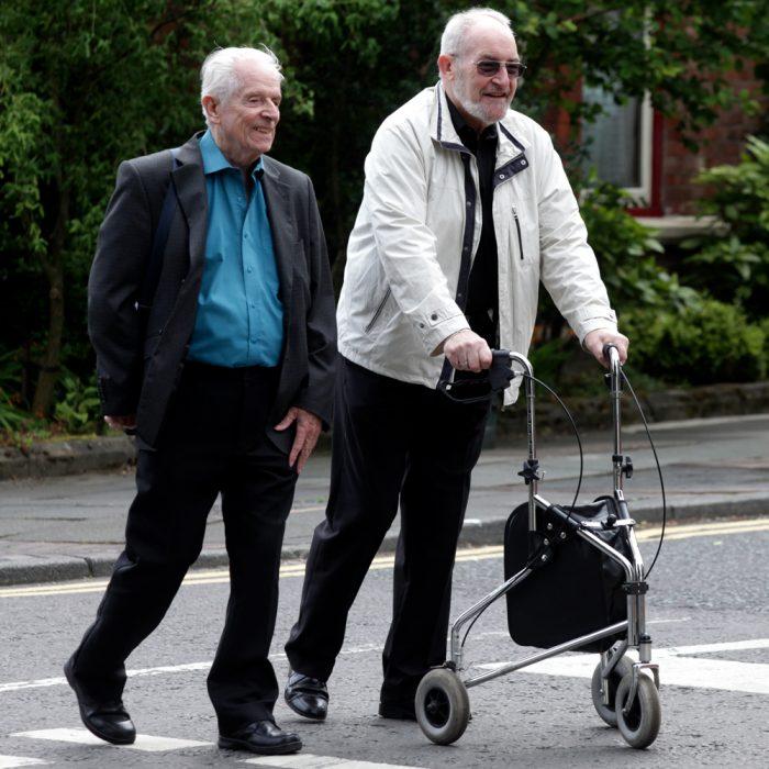 Senior gentlemen walking with walker.